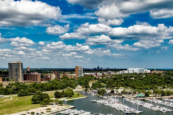 Milwaukee skyline with a blue sky and white clouds.