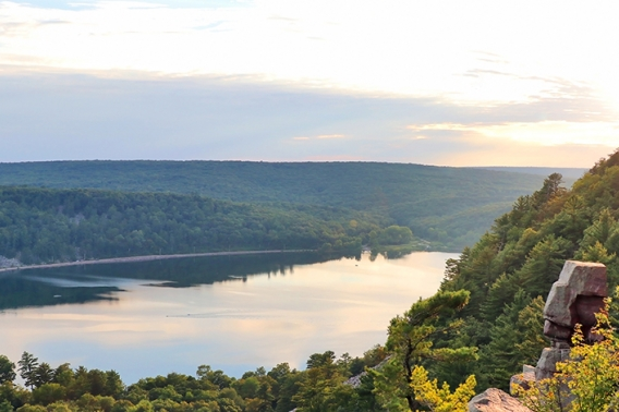 View of Devil's Lake from rocky ice age hiking trail during sunset.