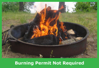 A warming fire which does not require a burning permit.